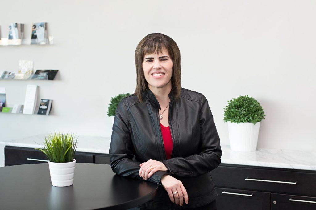 Beth Graf, author, at her desk.