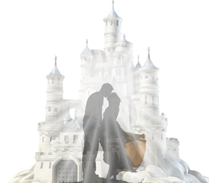 Two lovers kiss in front of a beautiful castle.