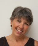 'Live Like You Are Living' by Glynis M Belec. Smiling woman.author smiling